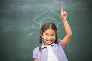 Graduation hat vector against smiling pupil raising her hand.jpeg